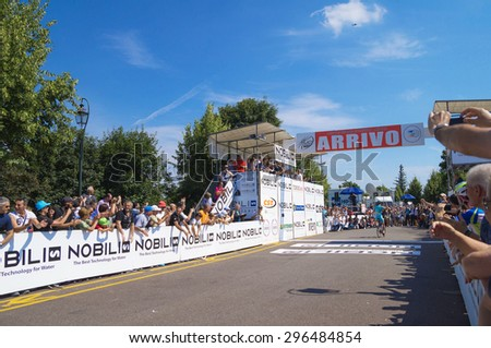 TORINO, ITALY - JUNE 27, 2015.. Vincenzo Nibali  winning  the 2015 Edition of the Cycling Italian Championship ,departure from Legnano and arrival in Torino, up at the Superga Cathedral. - stock photo