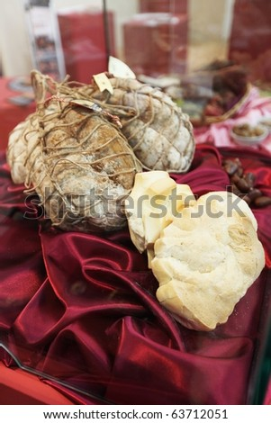 TORINO, ITALY - OCT. 24: Local food products in exhibition at Salone del Gusto, international fair of tastes and slow food October 24, 2010 in Torino, Italy. - stock photo