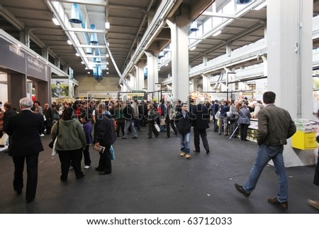 TORINO, ITALY - OCT. 24: People visiting Salone del Gusto, international fair of tastes and slow food October 24, 2010 in Torino, Italy. - stock photo