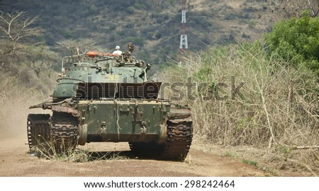 TORIT, SOUTH SUDAN-FEBRUARY 23, 2013: A wrecked tank stands in the road between Juba and Torit, a relick of civil war. - stock photo