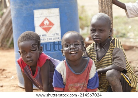TORIT, SOUTH SUDAN-FEBRUARY 21 2013: Unidentified boys play outside in the village of Torit, South Sudan - stock photo