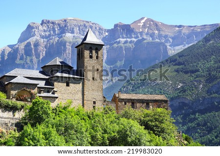 TORLA, SPAIN - JUNE 14, 2014: San Salvador Church. Torla is a gateway to the Ordesa y Monte Perdido National Park in the valley of Ordesa, and to Valle de Broto. - stock photo