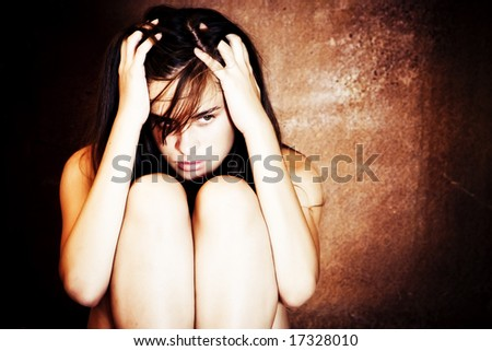 Tormented woman portrait in the darkness. - stock photo