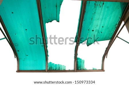 Torn and weathered green dome awning. - stock photo