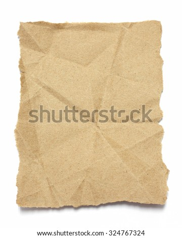 Torn brown  crumpled paper on white - stock photo