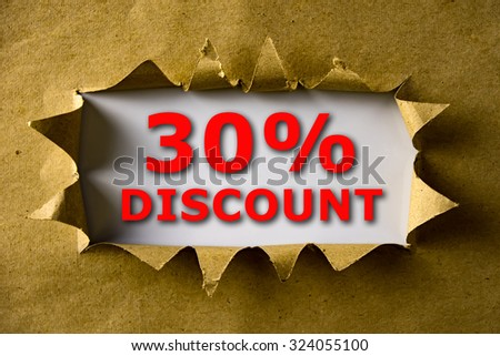 Torn brown paper with 30% DISCOUNT words - stock photo