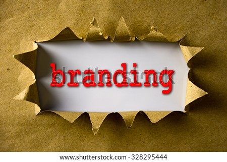 Torn brown paper with word Branding - stock photo