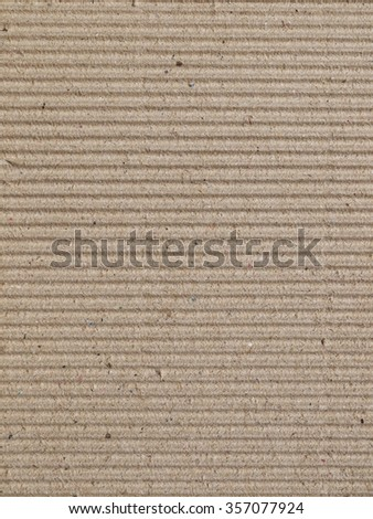 Torn cardboard sheet, brown paper box texture - stock photo