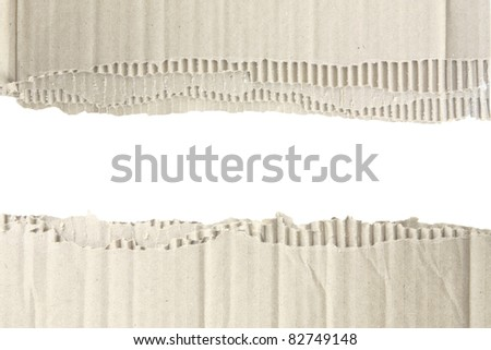Torn corrugated cardboard isolated on white - stock photo