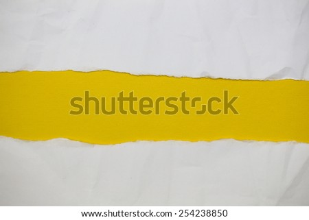 Torn creased paper with space for text with yellow background - stock photo