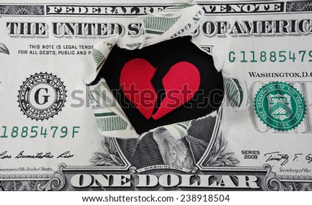 Torn dollar with broken red heart in the center                                - stock photo