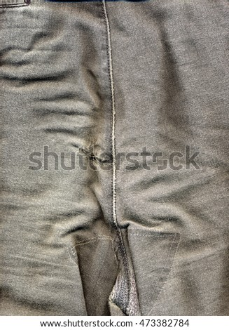 Torn jeans denim trousers with a hole