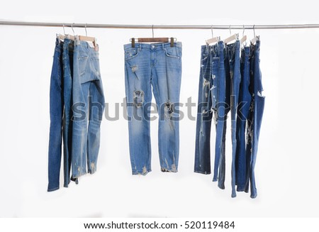 torn jeans on a hanger