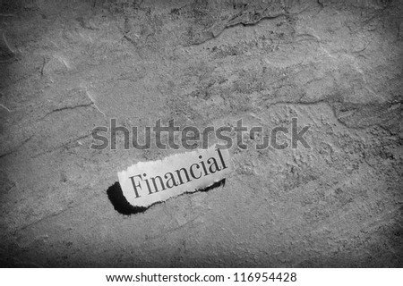 torn newspaper headline with Financial text - stock photo