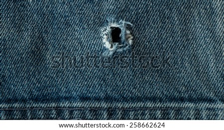 torn of  jeans background - stock photo