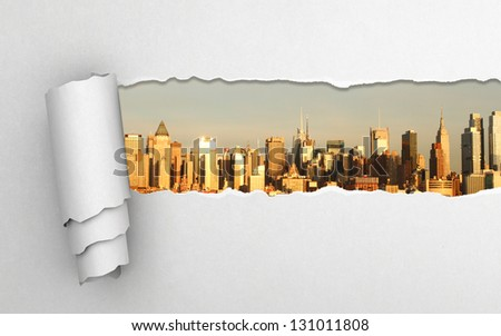 torn paper and modern city - stock photo