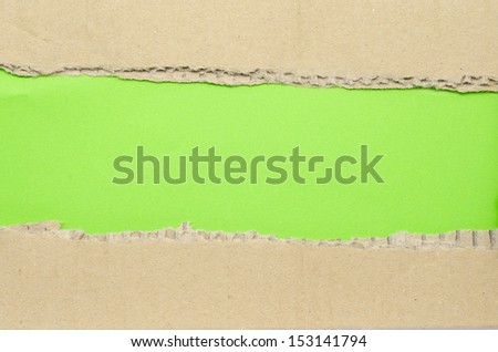 Torn Paper and space for text with green background  - stock photo