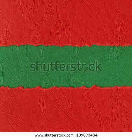 Torn paper background made of red and green horizontal strips. - stock photo