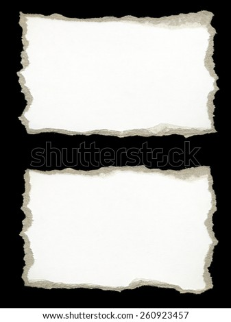 Torn Paper, isolated on black background.