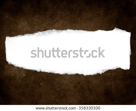Torn paper on brown. paper sign - stock photo