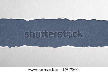 Torn paper with blue background