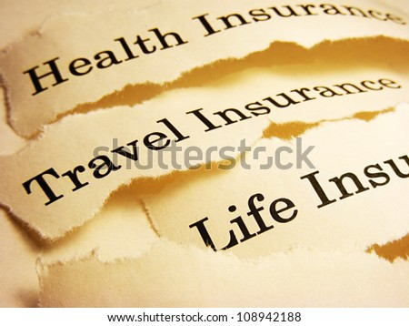 Torn paper with different types of insurance. Insurance concept. - stock photo