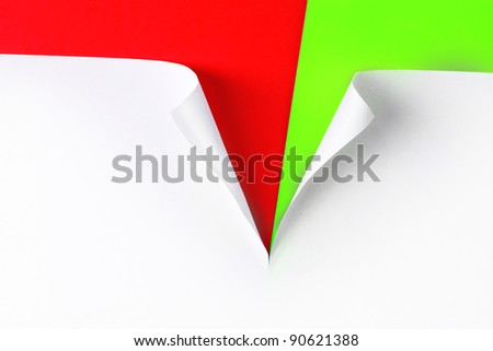 Torn paper with red and green  background