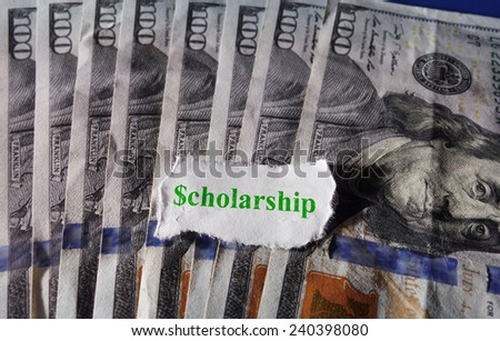 Torn paper with Scholarship text on hundred dollar bills                                - stock photo