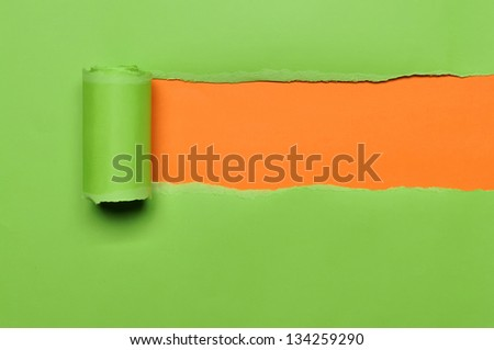 Torn paper with space for text with orange background
