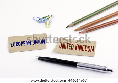 Torn paper with text: European Union and United Kingdom