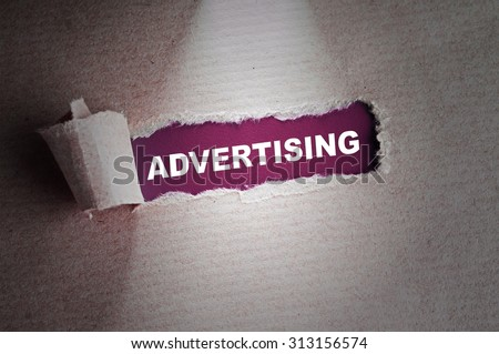 Torn paper with word Advertising