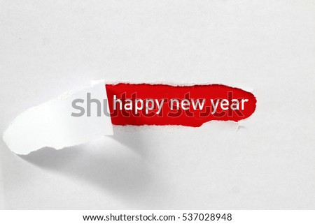 torn paper with word happy new year