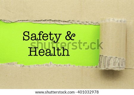 Torn Paper with word Safety & Health - stock photo