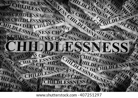 Torn pieces of paper with the word Childlessness. Concept Image. Black and White. Closeup.