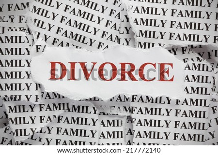 "Torn pieces of paper with the word ""Family"" and word ""Divorce"" in red color. Concept Image. Closeup. - stock photo"