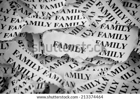 "Torn pieces of paper with the word ""Family"". Concept Image. Black and White. - stock photo"