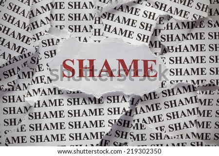 "Torn pieces of paper with words ""Shame"" - stock photo"