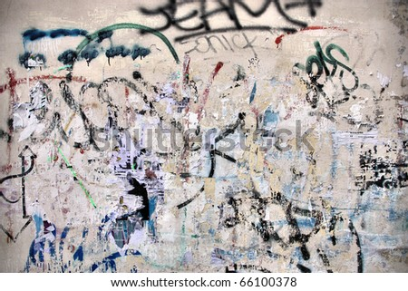 Torn posters on old wall, vandalism and urban decay - stock photo