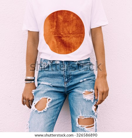 Torn vintage jeans and a T-shirt fashion geometry style - stock photo