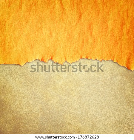 torn vintage paper over leather textured background - stock photo