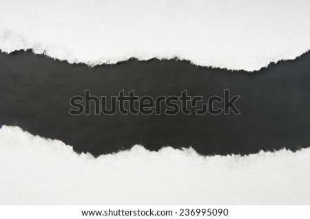 Torn white paper with black space - stock photo