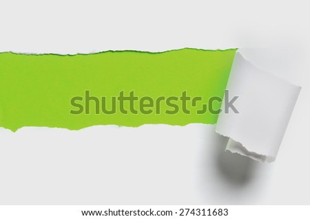 Torn white paper with green color as background