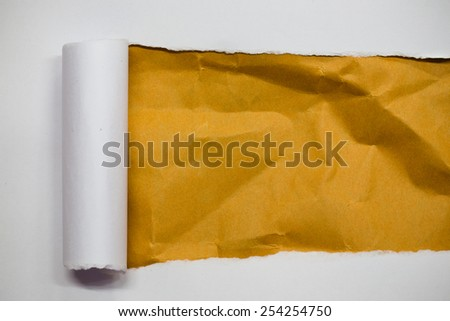 Torn white paper with space for text with creased brown paper background - stock photo