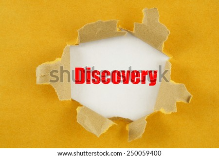 Torn yellow paper with word discovery on white background  - stock photo