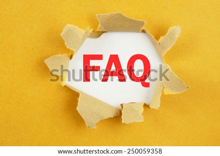 Torn yellow paper with word faq on white background  - stock photo