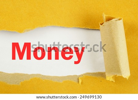 Torn yellow paper with word money on white background  - stock photo