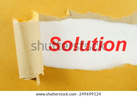 Torn yellow paper with word solution on white background  - stock photo