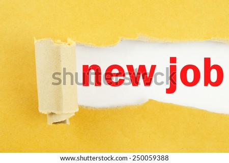 Torn yellow paper with words new job on white background - stock photo