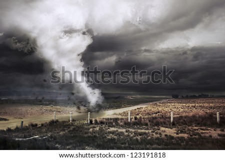 Tornado about to make damage - stock photo