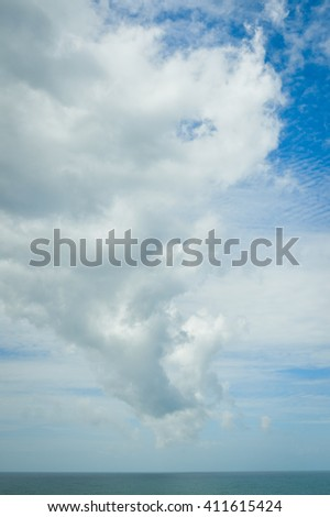 Tornado born during bad weather and storm with the wind over the ocean background - stock photo